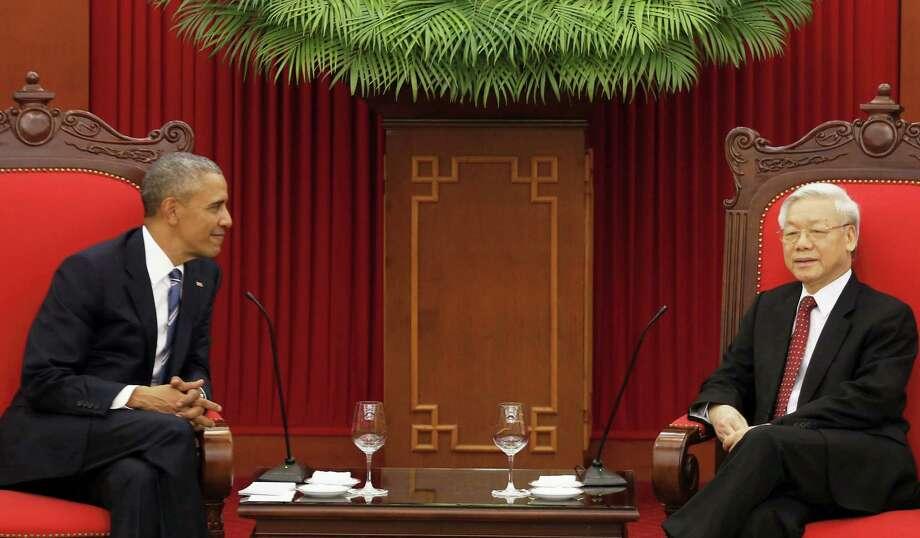 U.S. President Barack Obama, left, and Vietnam's Communist Party General Secretary Nguyen Phu Trong talk during their meeting in Hanoi, Vietnam on May 23, 2016. Photo: Kham/Pool Photo Via AP  / POOL Reuters