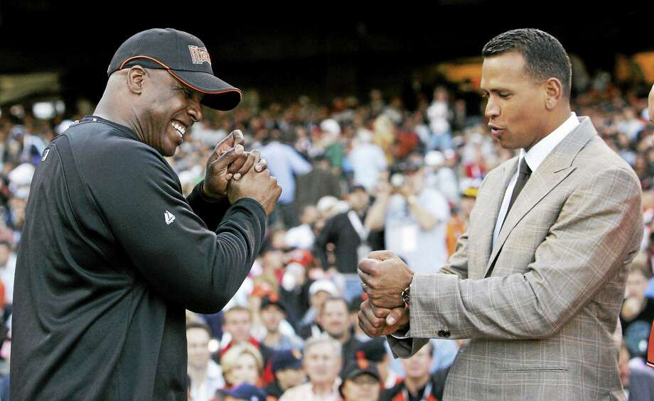 Alex Rodriguez, right, compares grips with Barry Bonds during the home run derby on July 9, 2007 in San Francisco. Photo: Jeff Chiu — The Associated Press File Photo  / AP2007