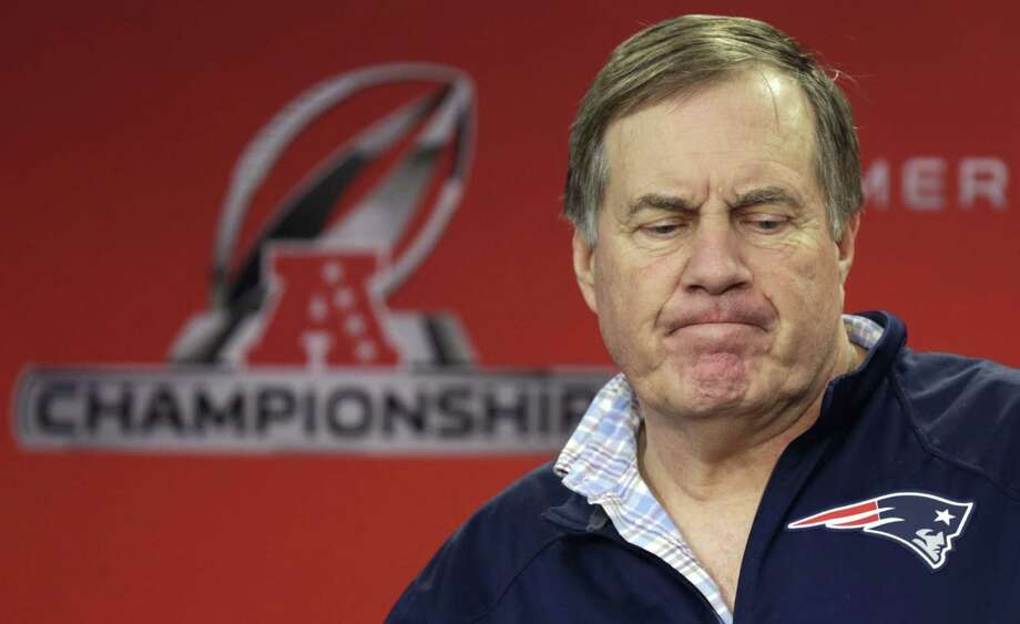 New England Patriots head coach Bill Belichick already received the largest fine for a coach in NFL history a few years ago. Now he faces more repercussions as the Patriots are trying to prepare for the Super Bowl against Seattle. Photo: Charles Krupa — The Associated Press  / AP