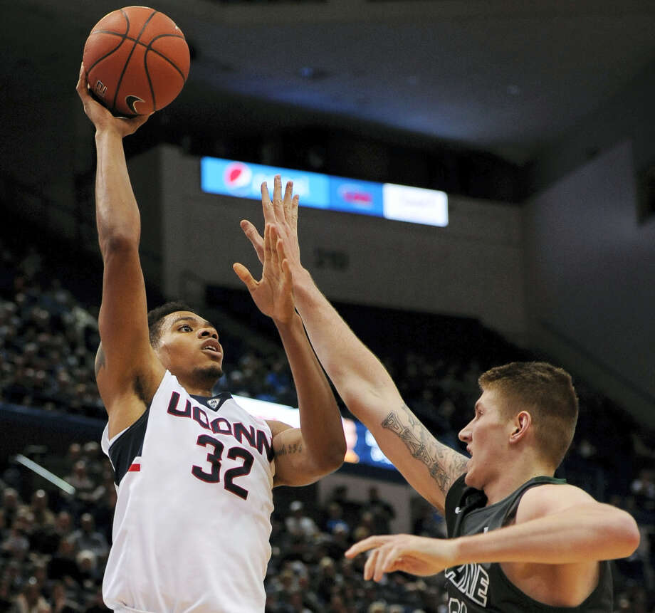 Connecticut's Shonn Miller, left, shoots over Tulane's Dylan Osetkowski in the second half of an NCAA college basketball game, Tuesday, Jan. 19, 2016, in Hartford, Conn. UConn won 60-42. (AP Photo/Jessica Hill) Photo: AP / AP2015