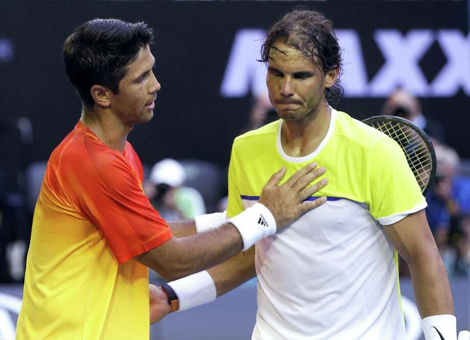 Rafael Nadal, right, of Spain is consoled by compatriot Fernando Verdasco after his first round loss to Verdasco at the Australian Open in Melbourne, Australia, Tuesday. Photo: The Associated Press  / AP
