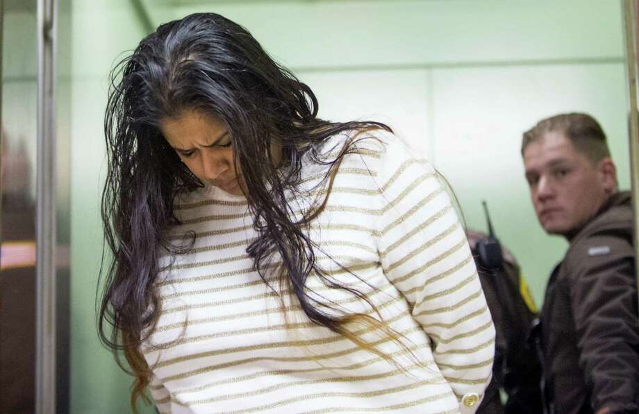 In this March 30, 2015 photo, Purvi Patel is taken into custody after being sentenced to 20 years in prison for feticide and neglect of a dependent on at the St. Joseph County Courthouse in South Bend, Ind. Photo: Robert Franklin/South Bend Tribune Via AP  / South Bend Tribune