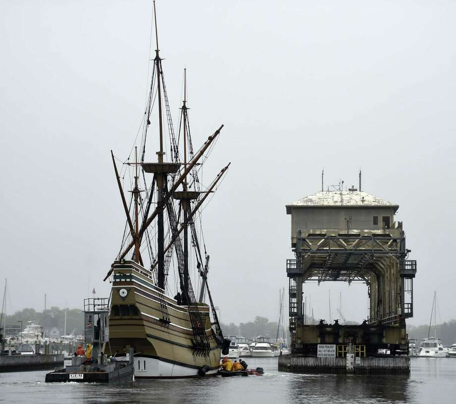 Towed by the tug Jaguar with support from Gwenmore Marine and Mystic Seaport waterfront small craft, the Mayflower II, a 1957 replica of the ship that carried the Pilgrims to Massachusetts in 1620, passes the Mystic River railroad bridge during the transit of the Mystic River, Tuesday, May 19, 2015 in Mystic, Conn. The ship, which is being restored at the Mystic Seaport's Henry B. duPont Preservation Shipyard in a cooperative effort between the Seaport and Plimoth Plantation, is en route back to Plymouth, Mass., for the summer tourism season and will return in the fall for another winter of work. (Sean D. Elliot/The Day via AP)  MANDATORY CREDIT Photo: AP / The Day