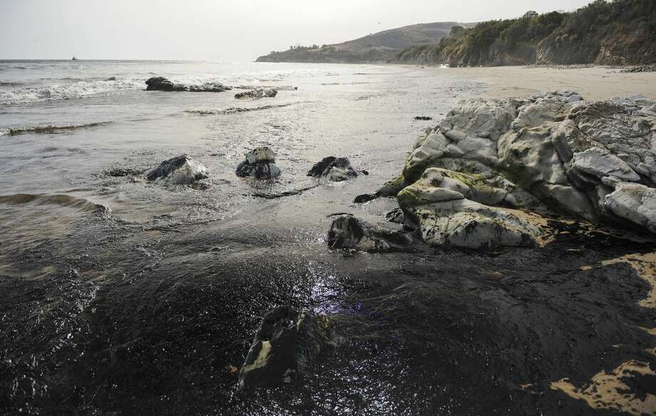An oil slick washes up on the shore Tuesday, May 19, 2015, near Goleta, Calif. Capt. Dave Zaniboni of the Santa Barbara County Fire Department says the pipeline on the land near Refugio State Beach broke Tuesday and spilled oil into a culvert that ran under the U.S. 101. (Kennth Song/The News-Press via AP) Photo: AP / The News-Press