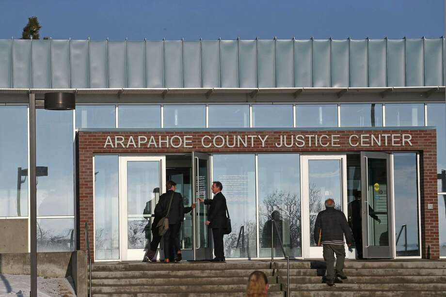 People enter the Arapahoe County Justice Center, in Centennial, Colo., Tuesday, Jan. 20, 2015. The jury selection process in the trial of Aurora theater shooting suspect James Holmes began Tuesday, and is expected to take several weeks to a few months. Holmes is charged with killing 12 people and wounding more than 50 in an Aurora movie theater in 2013. (AP Photo/Brennan Linsley) Photo: AP / AP