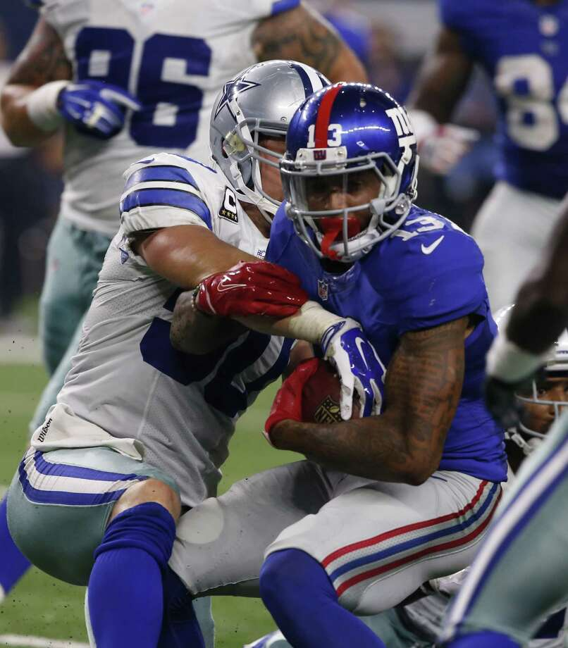 New York Giants receiver Odell Beckham is tackled by Dallas Cowboys linebacker Sean Lee during Sunday night's game in Arlington, Texas. Photo: Jose Yau — Waco Tribune-Herald  / Waco Tribune Herald