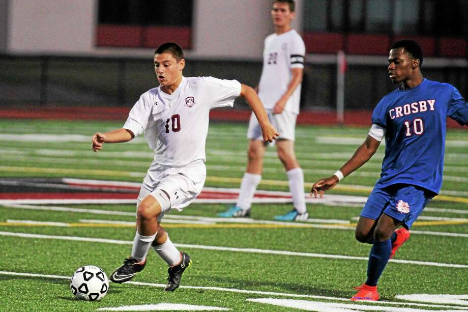 Torrington's Nick DallaValle dribbles the ball past a defender in his team's loss to Crosby Photo: Marianne Killackey — Register Citizen  / 2015