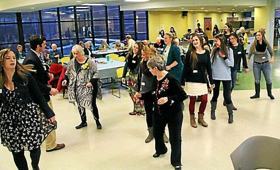 Lewis S. Mills High School's National Foreign Language Honor Society hosted its third annual Senior Citizen Prom on Jan. 16. Photo: Contributed Photos