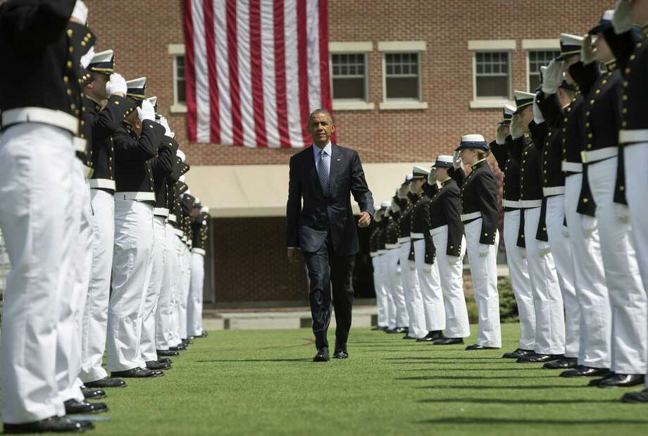 President Barack Obama is introduced at the U.S. Coast Guard Academy graduation in New London, Conn., Wednesday, May 20, 2015, before giving the commencement address. Photo: (AP Photo/Pablo Martinez Monsivais) / AP