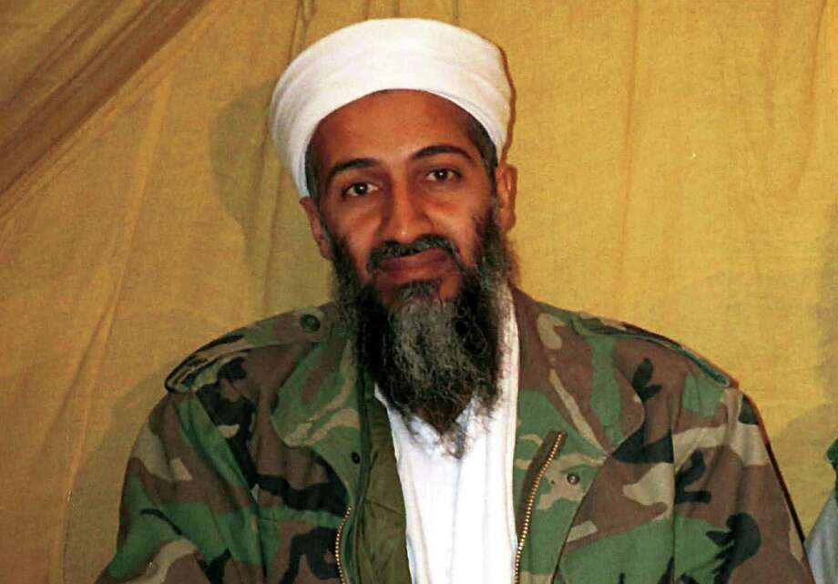 FILE - This undated file photo shows al Qaida leader Osama bin Laden in Afghanistan. U.S. intelligence officials have released more than 100 documents seized in the raid on Osama bin Ladenís compound, including a loving letter to his wife and a job application for his terrorist network. The Office of the Director of National Intelligence says the papers were taken in the Navy SEALs raid that killed bin Laden in Pakistan in 2011. Photo: (AP Photo, File) / AP