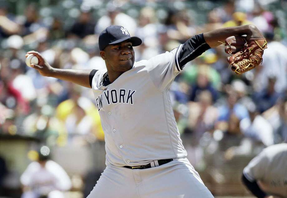 Yankees starting pitcher Michael Pineda throws in the first inning on Sunday. Photo: Eric Risberg — The Associated Press  / Copyright 2016 The Associated Press. All rights reserved. This material may not be published, broadcast, rewritten or redistribu