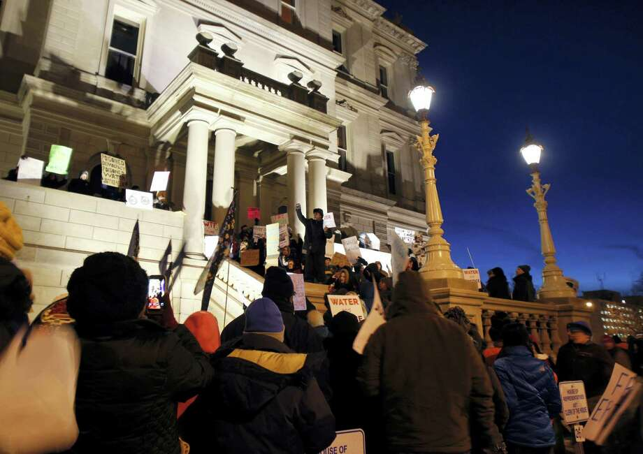 Protesters gather outside the state Capitol before Michigan Gov. Rick Snyder's State of the State address, Tuesday, Jan. 19, 2016, in Lansing, Mich. With the water crisis gripping Flint threatening to overshadow nearly everything else he has accomplished, the Republican governor again pledged a fix Tuesday night during his annual State of the State speech. Photo: AP Photo/Al Goldis   / FR11125 AP