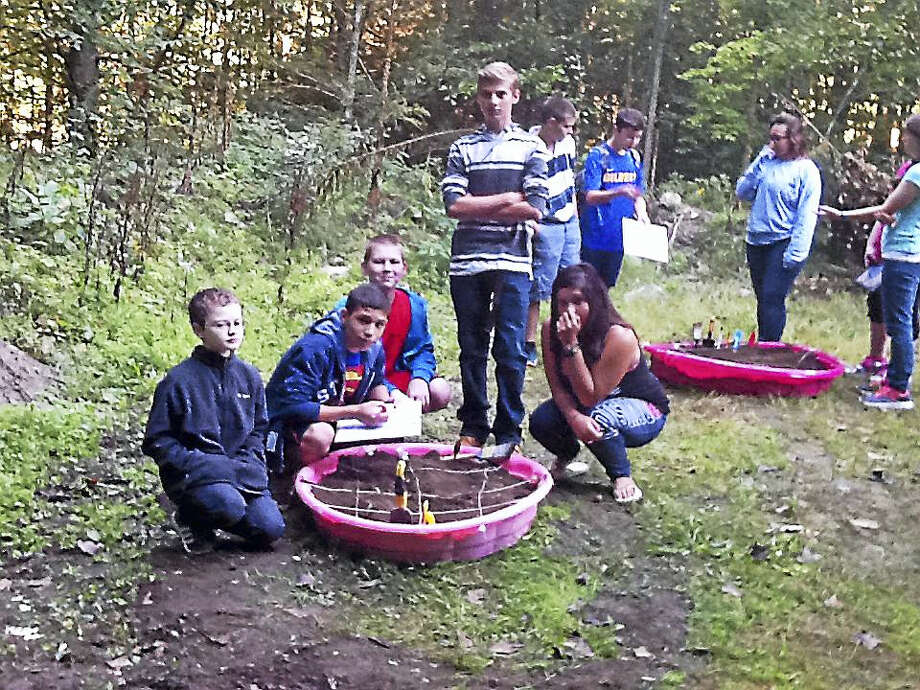 CONTRIBUTED PHOTOEighth-grade students at The Gilbert School took part in a mock archaeological dig Thursday. Photo: Journal Register Co.