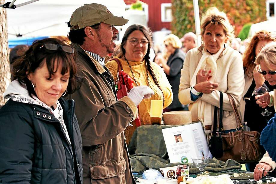 Contributed photo  Sally Camm, far left, and Tom Camm, beside her, speak to visitors at last yearís CT Wine and Cheese Festival, held in October at Hopkins Vineyard in New Preston. Most of the same food vendors and local farmers will be at the upcoming Farmstead Festival. And of course, Tom and Sally will be there, too, as organizers of the Farmstead Festival and directors of The Gary-The Olivia Theater, which will present snippets from this seasonís shows as the Festivalís entertainment. Photo: Journal Register Co.