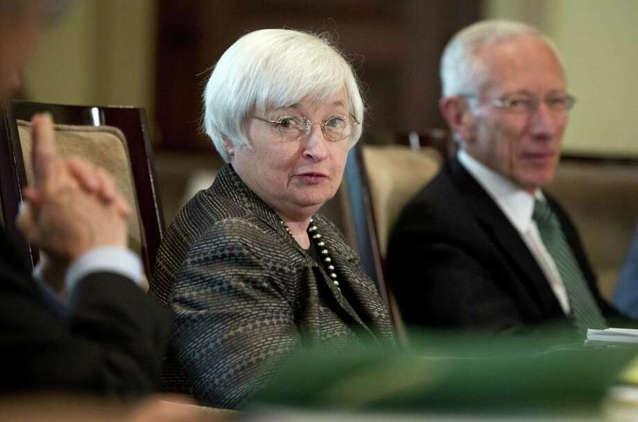 In this July 20, 2015 photo, Federal Reserve Chair Janet Yellen, from left, with Vice Chairman Stanley Fischer, and the board of governors of the Federal Reserve System, presides over a meeting in Washington. Photo: AP Photo/Manuel Balce Ceneta, File  / AP