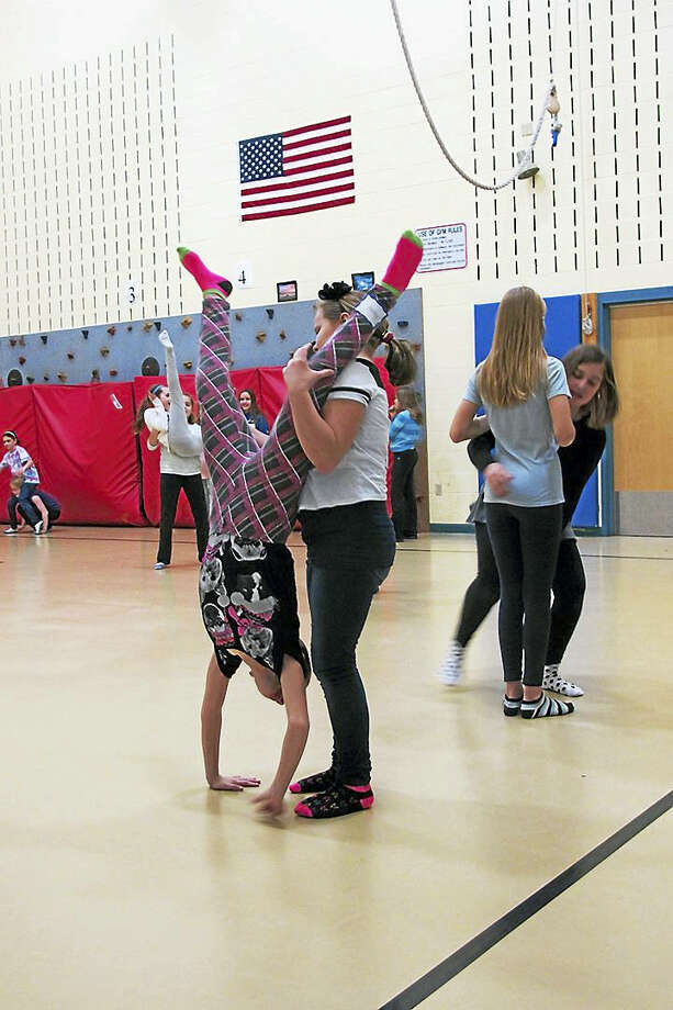 Contributed photos ASAP students learn dance maneuvers with Pilobolus members. Photo: Journal Register Co.