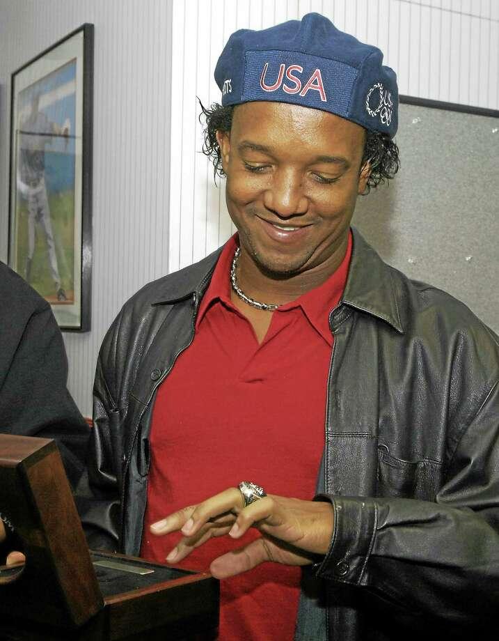 Pedro Martinez looks at his 2004 World Series ring. Photo: Julie Cordeiro — The Associated Press File Photo