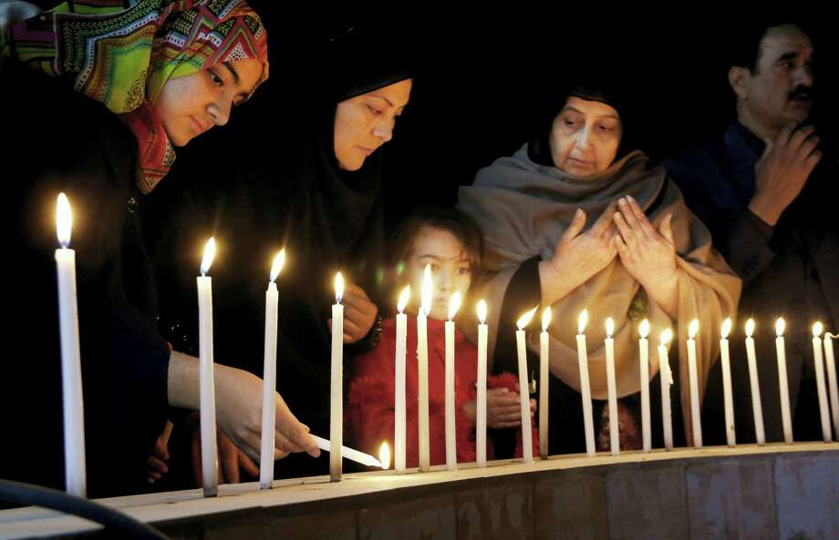 Pakistani women light candles during a vigil for victims of the Bacha Khan University attack, Wednesday, Jan. 20, 2016 in Peshawar, Pakistan. Taliban gunmen stormed a university in northwestern Pakistan on Wednesday, killing many people and triggering an hours-long gun battle with the army and police before the military declared that the assault in a town near the city of Peshawar was over. Photo: AP Photo/Mohammad Sajjad / AP