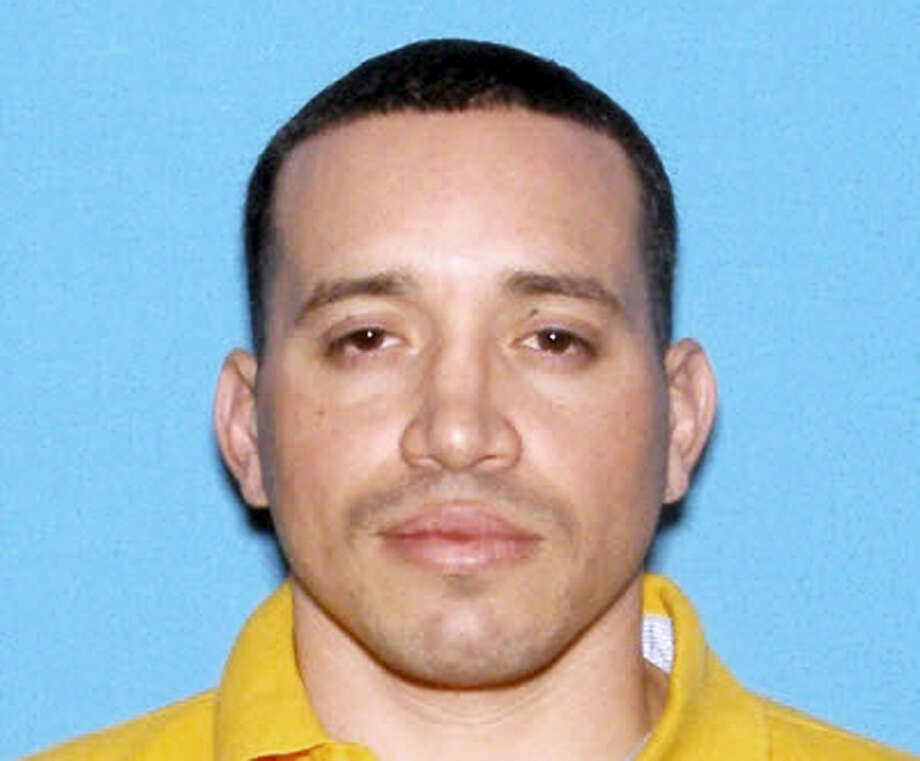 This undated identification photo released by the Massachusetts State Police shows Jorge Zambrano, killed Sunday, May 22, 2016, during an exchange of gunfire with police at an apartment building in Oxford, Mass. Zambrano had been suspected in the shooting death of Auburn, Mass., Police Officer Ronald Tarentino during a traffic stop early Sunday morning. Photo: Massachusetts State Police Via AP / Massachusetts State Police