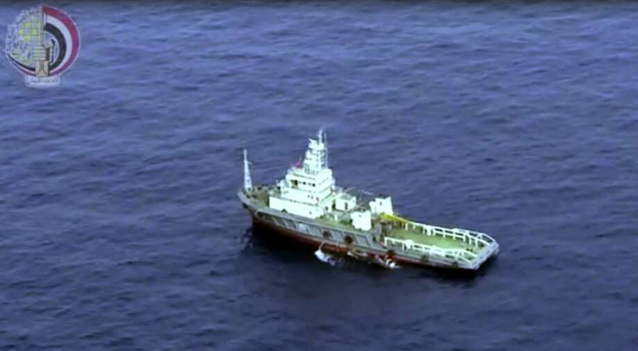This still image taken from video posted Saturday, May 21, 2016, on the official Facebook page of the Egyptian Armed Forces spokesman shows an Egyptian ship collecting wreckage of EgyptAir flight 804. Smoke was detected in multiple places on EgyptAir flight 804 moments before it plummeted into the Mediterranean, but the cause of the crash that killed all 66 on board remains unclear, the French air accident investigation agency said on Saturday. Photo: Egyptian Armed Forces Via AP / Egyptian Armed Forces
