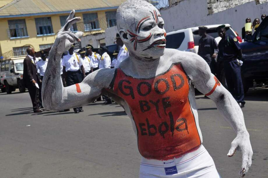 A man takes part in the celebrations, to mark Liberia being an Ebola free nation in Monrovia, Liberia on May 11, 2015. Liberians are gathering in the streets of the capital to celebrate the end of the Ebola epidemic in this West African country. Photo: AP Photo/ Abbas Dulleh  / AP