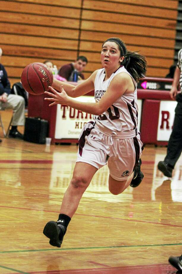 Torrington's Shannon Reardon drives in on a tough night under the Raider hoop. Reardon sank the team's only 3-pointer from outside. Photo: Marianne Killackey - For Register Citizen  / 2015