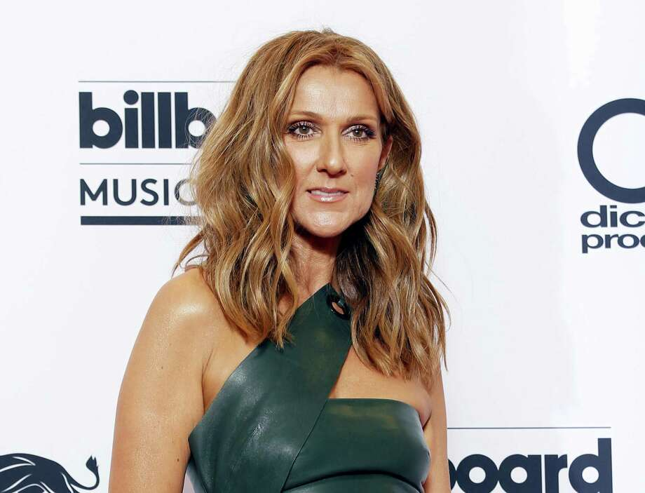 "In this May 17, 2015 photo, Celine Dion poses at the Billboard Music Awards in Las Vegas. Dion will perform Queen's ""The Show Must Go On,"" at the Billboard Music Awards on May 22, 2016. Photo: Photo By Eric Jamison/Invision/AP, File  / AP"