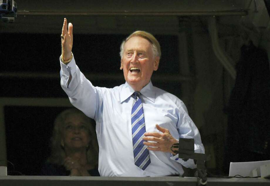 Hall of fame broadcaster Vin Scully acknowledges fans prior to Tuesday's game between the Dodgers and the Giants. Photo: Mark J. Terrill — The Associated Press  / Copyright 2016 The Associated Press. All rights reserved.