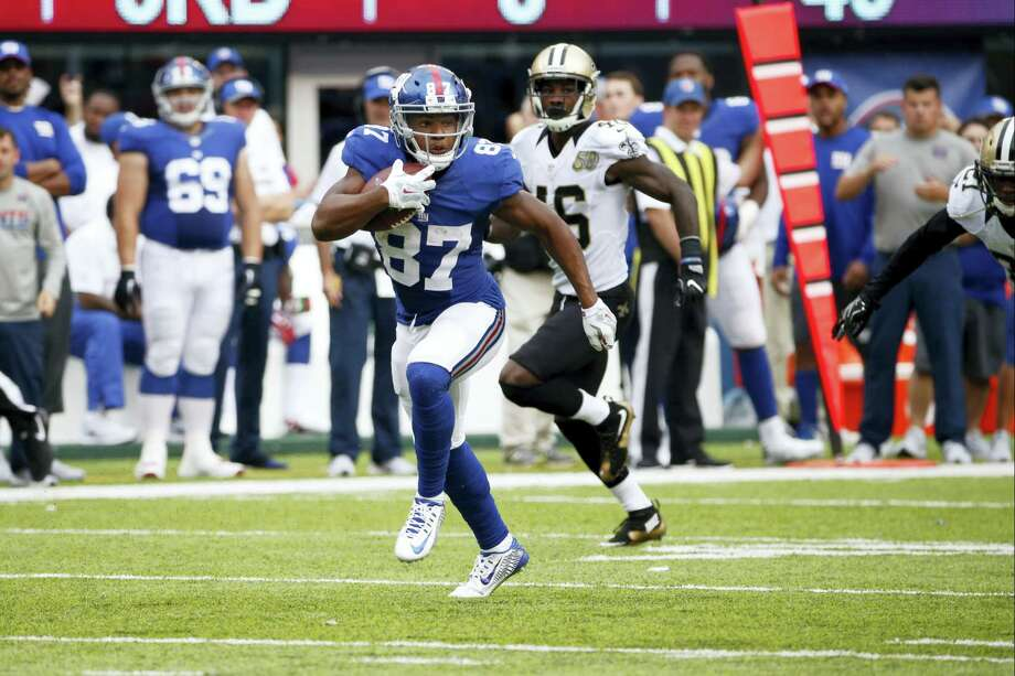 Giants wide receiver Sterling Shepard (87) runs away from the Saints' Ken Crawley (46) during the second half Sunday. Photo: Kathy Willens — The Associated Press  / AP