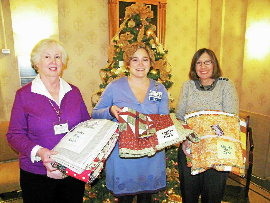 Members from Quilts that Care donate at least four quilts a month the Charlotte Hungerford Hospital. Photo: Contributed Photo