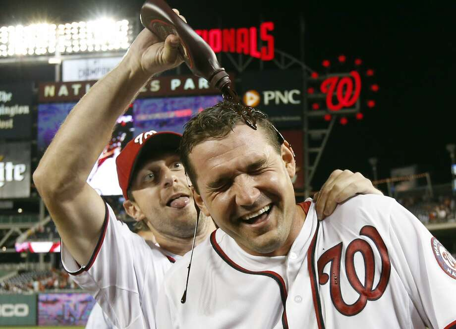 The Nationals' Ryan Zimmerman gets doused with chocolate syrup by Max Scherzer after his two-run walk-off home run gave the Nationals an 8-6 win over the Yankees in 10 innings. Photo: Alex Brandon — The Associated Press  / AP