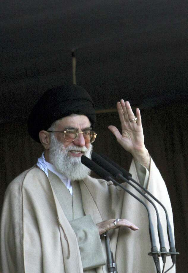 """In this Friday Nov. 4, 2005, file photo. Iran's supreme leader Ayatollah Ali Khamenei, waves to people who attend in Eid al-Fitr prayer the holiday marking the end of the Muslim holy month of Ramadan in Tehran. In his first public remarks since international sanctions were lifted following a U.N. report that Iran had fully complied in scaling back its nuclear program,  Khamenei said Tehran should """"exercise care the other party implements its commitments."""" Photo: AP Photo/Hasan Sarbakhshian, File   / AP"""