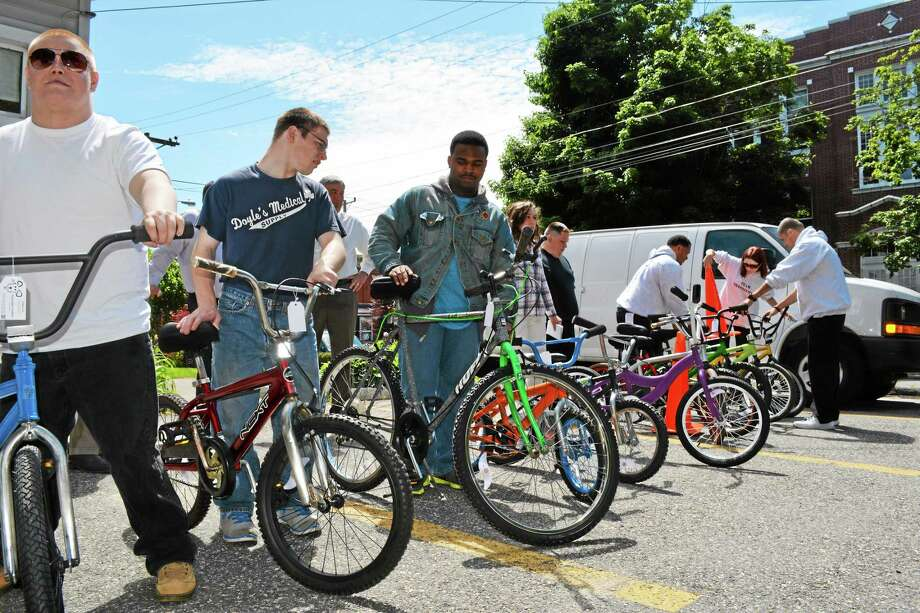 Students in LARC's School to Community Transition Program show off donated bicycles in this file photo. Photo: Register Citizen File Photo