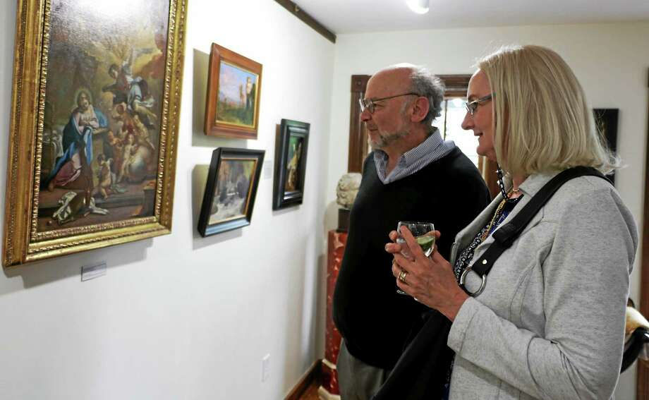 Joe and Jane Keiffer, residents of New York city, look at some of the work at Pinacoteca. Photo: John Fitts — The Register Citizen