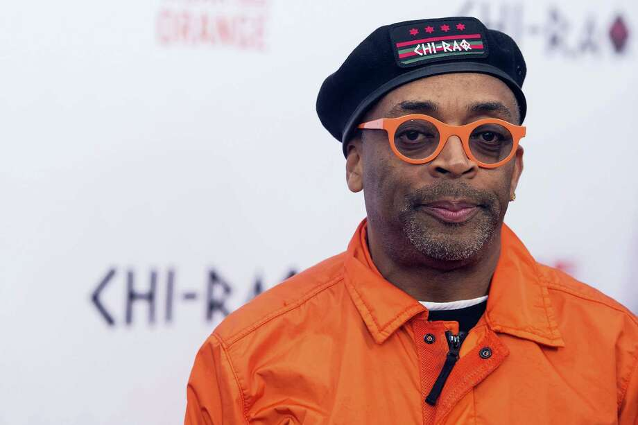 """FILE - In a Tuesday, Dec. 1, 2015 file photo, Spike Lee attends the premiere of """"Chi-Raq"""" at the Ziegfeld Theatre, in New York. Calls for a boycott of the Academy Awards are growing over the Oscars' second straight year of mostly white nominees, as Spike Lee and Jada Pinkett Smith each said Monday, Jan. 17, 2016, that they will not attend this year's ceremony.  (Photo by Charles Sykes/Invision/AP, File) Photo: Charles Sykes/Invision/AP / Invision"""
