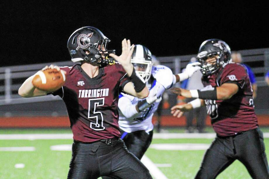 Marianne Killackey - Special to Register Citizen Torrington's Connor Finn steps back to pass against Crosby Friday night. Photo: Journal Register Co. / 2015