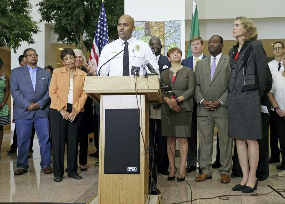 Charlotte-Mecklenburg Police Chief Kerr Putney speaks as city officials, including Charlotte mayor Jennifer Roberts, right, listen during a news conference after a second night of violence following Tuesday's fatal police shooting of Keith Lamont Scott in Charlotte, N.C. Thursday, Sept. 22, 2016. Photo: AP Photo/Chuck Burton   / Copyright 2016 The Associated Press. All rights reserved.