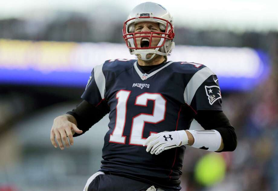 Quarterback Tom Brady will be playing in his 10th AFC championship game on Sunday when the Patriots take on the Broncos. Photo: Charles Krupa — The Associated Press  / AP