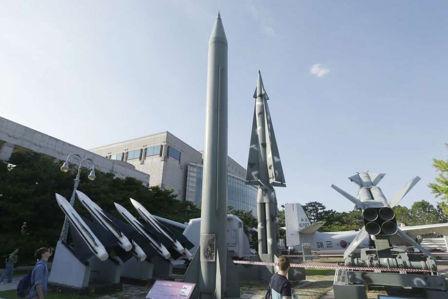 Visitors look at models of North Korea's Scud-B missile, center left, and other South Korean missiles on display at the Korea War Memorial Museum in Seoul, South Korea on Sept. 15, 2015. A day after threatening long-range rocket launches, North Korea declared Tuesday that it has upgraded and restarted all its atomic fuel plants so it can produce more - and more sophisticated - nuclear weapons. Photo: AP Photo/Ahn Young-joon  / AP