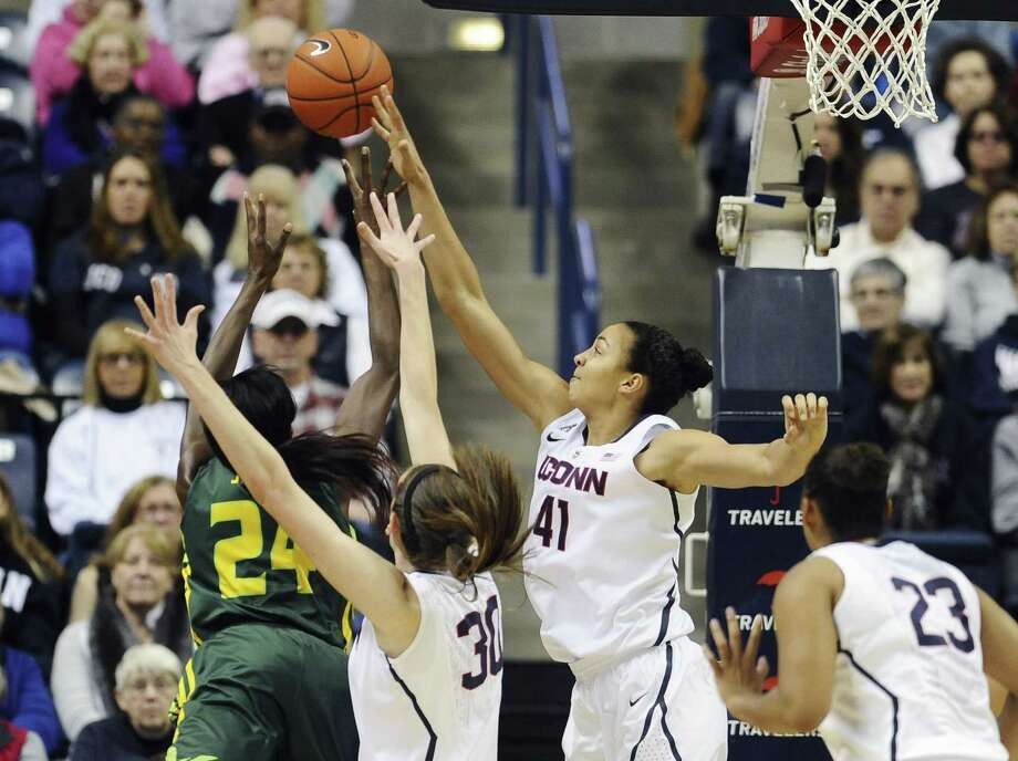 UConn's Kiah Stokes, right, blocks a shot attempt by South Florida's Alisia Jenkins during the first half Sunday in Storrs. Photo: Jessica Hill — The Associated Press  / FR125654 AP