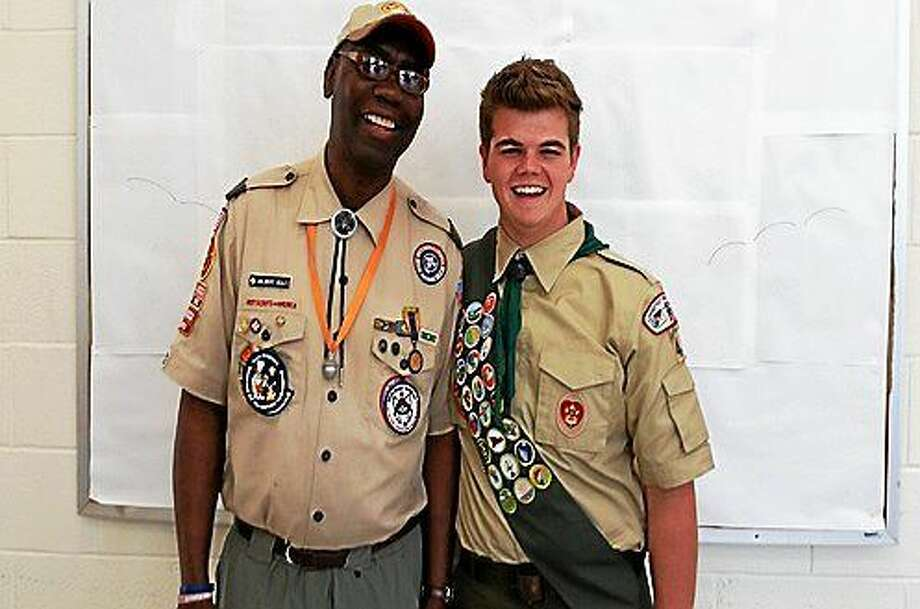 Taylor Yurgalevicz, 18, of Torrington became the latest local young man to attain the rank of Eagle Scout during Sunday afternoon's Eagle Court of Honor ceremony at the First United Methodist Church at 21 Fern Drive in Torrington. Joining Yurgalevicz is Troop 4 Scoutmaster Wilbert Boles, Jr. Photo: N. F. Ambery--Special To The Register Citizen