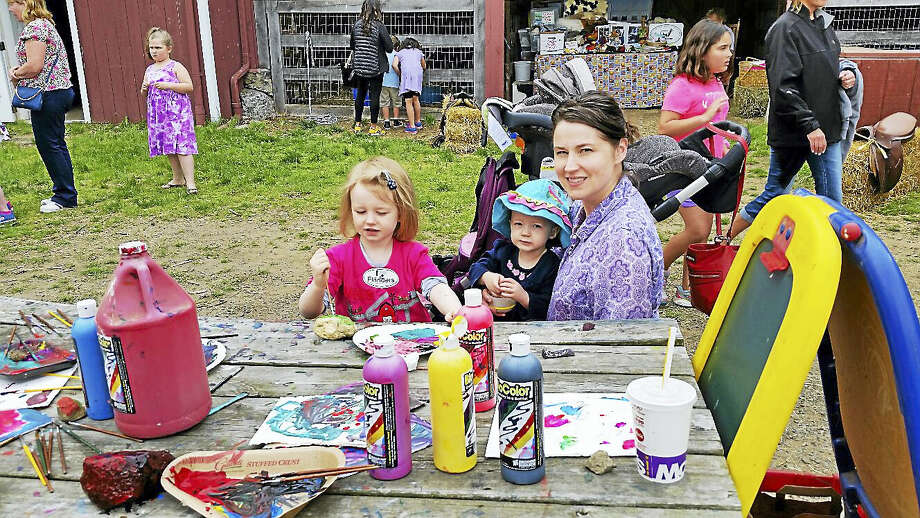 Rebecca Ritter of Woodbury with her daughters Vivian, 3, and Audrielle, 1, made arts and crafts during Farm Day at Flanders Nature Center Photo: N.F. Ambery — The Register Citizen