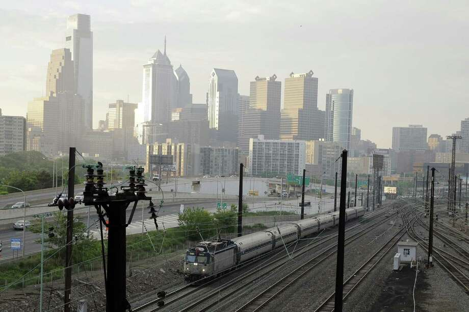 An Amtrak train travels northbound from 30th Street Station on Monday, May 18, 2015 in Philadelphia. Amtrak's Northeast Corridor trains resumed service Monday following last week's deadly derailment that killed eight people and injured more than 200 others. Photo: AP Photo/Matt Slocum  / AP