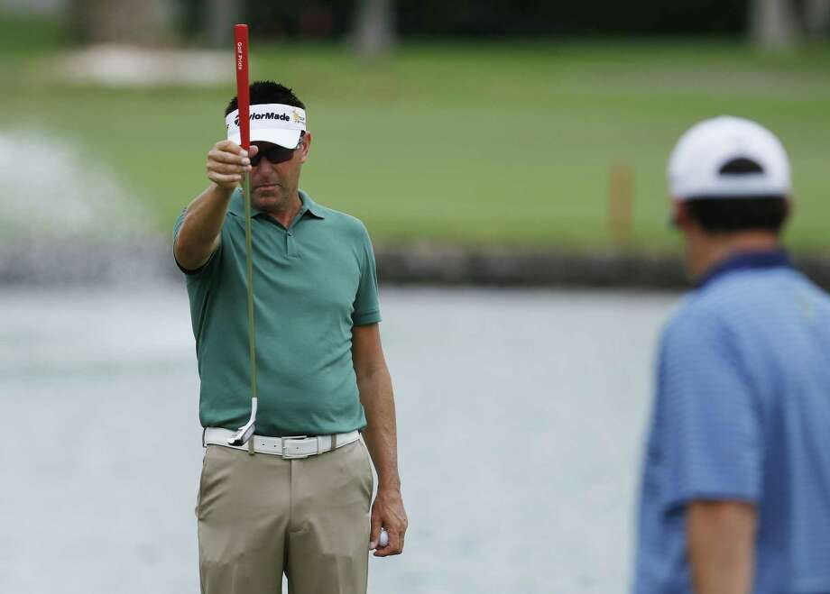 Robert Allenby of Australia lines up his ball during the second round of the Sony Open Friday in Honolulu. Allenby says he was robbed, beaten and dumped in a park Saturday Jan. 17, 2015 after missing the cut in the Sony Open, leaving him with cuts and a deep scrape on his forehead. (AP Photo/Hugh Gentry) Photo: The Associated Press  / FR159897 AP