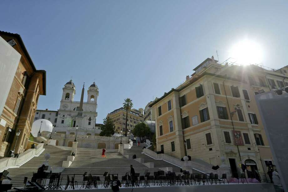 Chairs are set up to host a concert in front of the world-famous Spanish Steps before the start of a press conference to present the reopening of the site at the end of a 10-month restoration, in which Bulgari jewelry house participated, in Rome, Thursday, Sept. 22, 2016. The Spanish Steps will open again to the public on Friday. Photo: AP Photo/Andrew Medichini   / Copyright 2016 The Associated Press. All rights reserved.