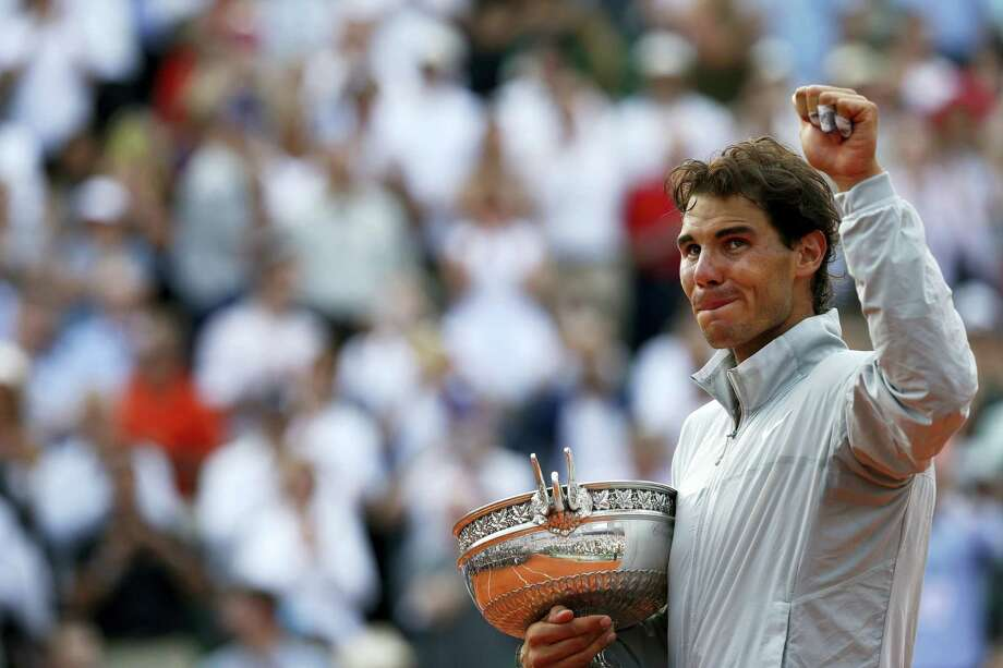 "This June 8, 2014,  file photo shows Spain's Rafael Nadal holding the trophy after winning the final of the French Open tennis tournament against Serbia's Novak Djokovic at the Roland Garros stadium, in Paris, France. Nadal appears to be inching closer to finding his old ""King of Clay"" form. Photo: The Associated Press  / AP"