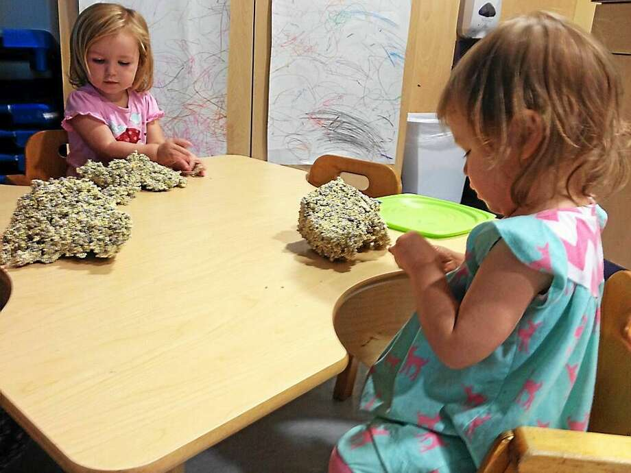 Children play with Floam inside the new Child Care Center at Maria Seymour Brooker Memorial in Torrington. Photo: Amanda Webster — The Register Citizen