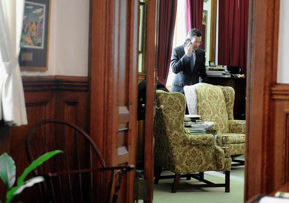Connecticut Gov. Dannel P. Malloy takes a phone call in his office at the state Capital before he is sworn in for his second term on Jan. 7, 2015 in Hartford, Conn. Photo: AP Photo/Jessica Hill  / FR125654 AP
