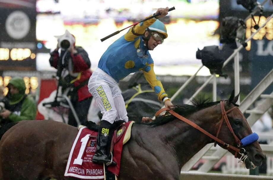 Jockey Victor Espinoza, celebrates aboard American Pharoah after winning the 140th Preakness Stakes horse race at Pimlico Race Course, Saturday, May 16, 2015, in Baltimore. Photo: AP Photo/Brynn Anderson  / AP