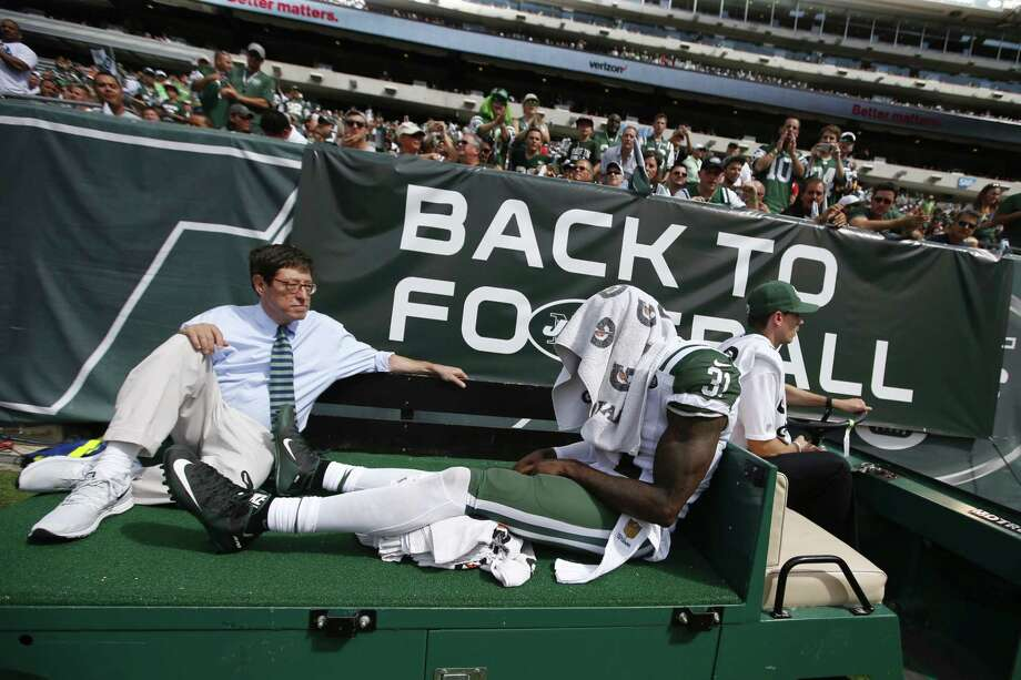 New York Jets defensive back Antonio Cromartie is carted off the field after being injured Sunday. Photo: Jason DeCrow — The Associated Press  / FR103966 AP